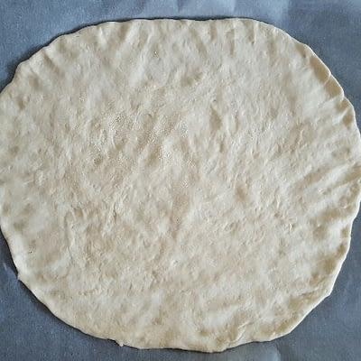 Recette de base pâte à pizza aplatissez la pâte